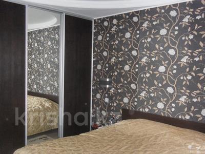 4-комнатная квартира, 110 м², 3/12 эт., Валиханова 1 за 38 млн ₸ в Нур-Султане (Астана), р-н Байконур — фото 8