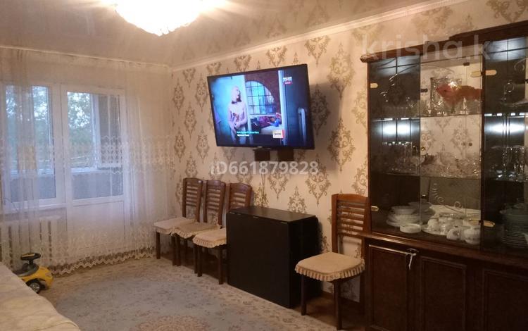 3-комнатная квартира, 64 м², 4/4 этаж, 2 мкр 18 за 12.5 млн 〒 в Капчагае