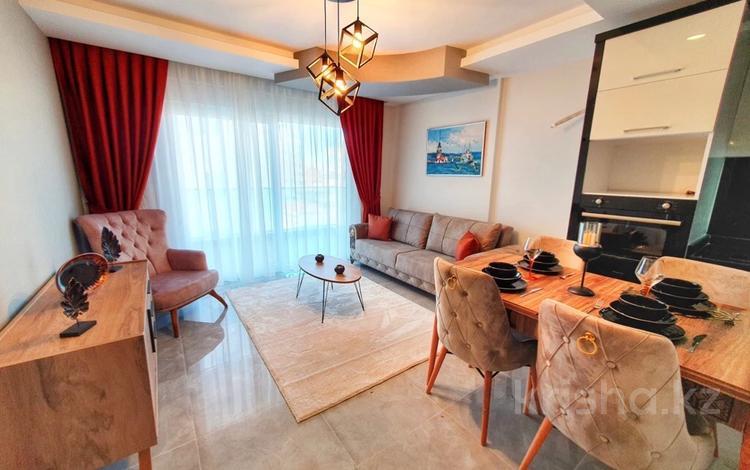 2-комнатная квартира, 55 м², 9/12 этаж, Махмутлар за 23.5 млн 〒 в