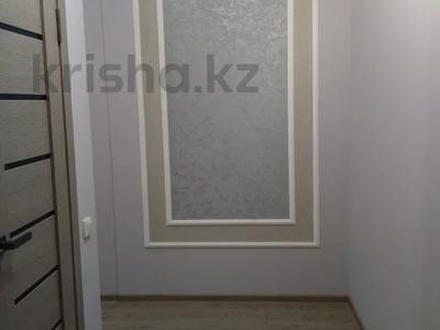 2-комнатная квартира, 54 м², 10/14 этаж помесячно, мкр Акбулак за 120 000 〒 в Алматы, Алатауский р-н — фото 9