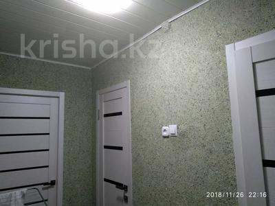 3-комнатная квартира, 62.5 м², 9/9 этаж, Мамраева 4 за 11.5 млн 〒 в Караганде, Октябрьский р-н — фото 5