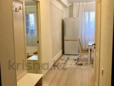 1-комнатная квартира, 45 м², 1/5 этаж посуточно, Микрорайон Каратал 45 за 12 000 〒 в Талдыкоргане — фото 2