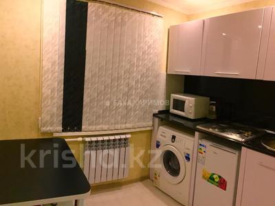 1-комнатная квартира, 33 м² посуточно, проспект Нуркена Абдирова 6 — проспект Бухар жырау за 6 000 〒 в Караганде, Казыбек би р-н — фото 4