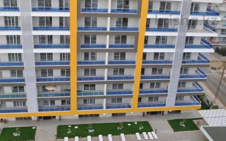 3-комнатная квартира, 105 м², 1/10 этаж, Махмутлар за 27.6 млн 〒 в