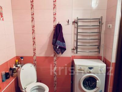 1-комнатная квартира, 52.5 м², 7/9 этаж, мкр Аксай-1А 27 за 18 млн 〒 в Алматы, Ауэзовский р-н — фото 8