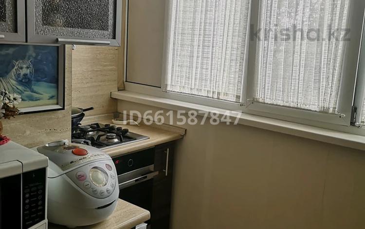 4-комнатная квартира, 90 м², 3/5 этаж, Гарышкер 33 — Алдабергенова за 25 млн 〒 в Талдыкоргане