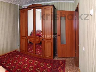 4-комнатная квартира, 77 м², 3/5 этаж, Гапеева за 16 млн 〒 в Караганде, Казыбек би р-н — фото 5