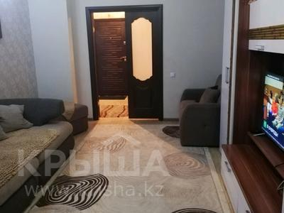 2-комнатная квартира, 55 м², 15/17 этаж, Богенбай батыра 56 за 18 млн 〒 в Нур-Султане (Астана), р-н Байконур — фото 2