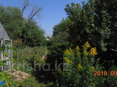 4-комнатный дом, 58 м², 7 сот., Защитная 20 за 8.5 млн 〒 в Караганде, Казыбек би р-н — фото 2