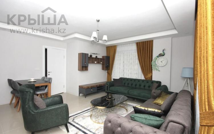 3-комнатная квартира, 100 м², 1/6 этаж, Махмутлар за 29 млн 〒 в