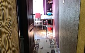 4-комнатная квартира, 61.5 м², 2/5 этаж, 17 микрорайон 49 за 13.5 млн 〒 в Караганде, Октябрьский р-н