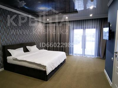 2-комнатная квартира, 200 м² посуточно, Гаухар-Ана 210 — Токаева за 25 000 〒 в Талдыкоргане — фото 4