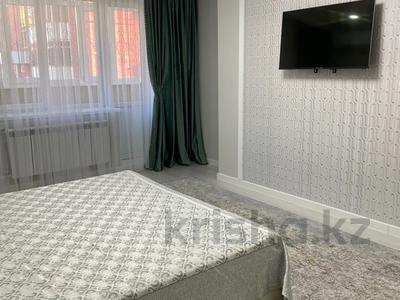 1-комнатная квартира, 55 м², 1/5 этаж посуточно, Мкр Каратал 59 в за 15 000 〒 в Талдыкоргане — фото 2