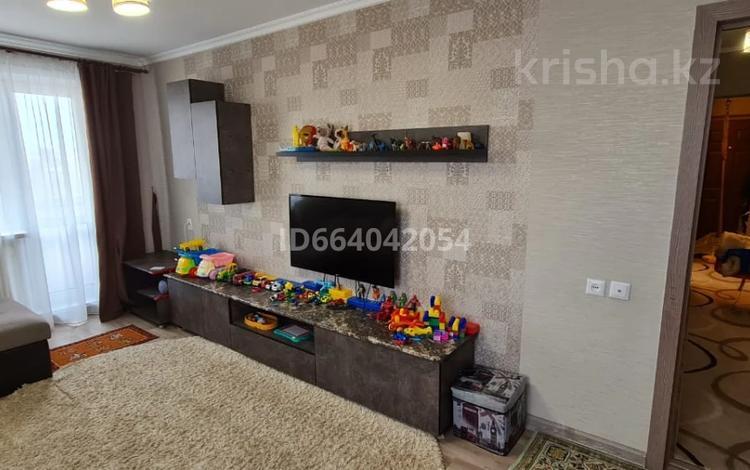 2-комнатная квартира, 51 м², 9/9 этаж, Сатыбалдина 10 за 15.3 млн 〒 в Караганде, Казыбек би р-н