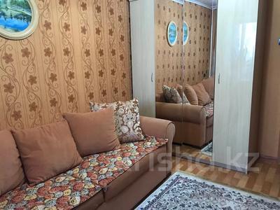 4-комнатная квартира, 80 м², 6/9 этаж, Сатыбалдина 7 за 20 млн 〒 в Караганде, Казыбек би р-н — фото 10