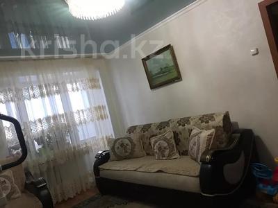4-комнатная квартира, 80 м², 6/9 этаж, Сатыбалдина 7 за 20 млн 〒 в Караганде, Казыбек би р-н — фото 11
