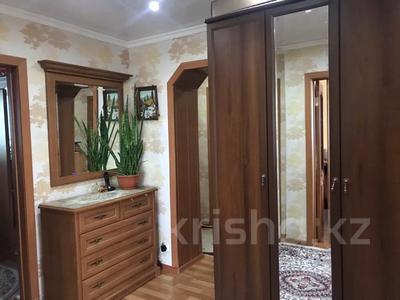 4-комнатная квартира, 80 м², 6/9 этаж, Сатыбалдина 7 за 20 млн 〒 в Караганде, Казыбек би р-н — фото 2